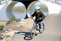 Dustin Luo, 6, rides Friday, April 2, 2021, on the pump track at Fort Smith's Riverfront Skate and Bike Park. Dustin was riding with his brother at the park that also includes a bicycle playground for younger riders. Check out nwaonline.com/210403Daily/ and nwadg.com/photos for a photo gallery.<br /> (NWA Democrat-Gazette/David Gottschalk)