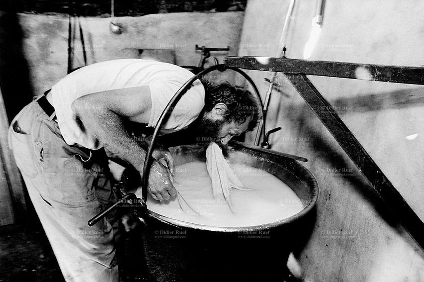 Switzerland. Canton Ticino. Verzasca valley. Piche Negro Alp. MIchele Sonognini makes cheese. Cooper caldron. Manual labor. Labour force. Season spent by the goats in mountain pastures. Swiss alpine farmers. Alps mountains peasants.  © 1996 Didier Ruef