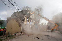 Nepalese Govt. workers demolish a damaged building by last Tuesday's earthquake. Shanku, near Kathmandu, Nepal. May 13, 2015