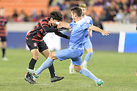 Houston, TX - Friday December 9, 2016: Amir Bashti (11) of the Stanford Cardinal and Alex Comsia (4) of the North Carolina Tar Heels battle for control of the ball at the NCAA Men's Soccer Semifinals at BBVA Compass Stadium in Houston Texas.