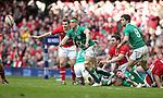 Ireland number 8 Jamie Heaslip gets the ball away from the breakdown..RBS 6 Nations.Wales v Ireland.Millennium Stadium.02.02.13.©Steve Pope-SPORTINGWALES