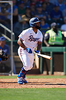Danny Santana (38) of the Texas Rangers follows through on a swing during a Cactus League Spring Training game against the Los Angeles Dodgers on March 8, 2020 at Surprise Stadium in Surprise, Arizona. Rangers defeated the Dodgers 9-8. (Tracy Proffitt/Four Seam Images)