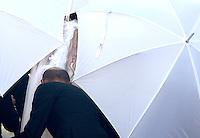 L'attrice e soubrette Valeria Marini nascosta in parte dagli ombrelli della security al suo arrivo alla Basilica di Santa Maria in Aracoeli per la cerimonia nuziale con l'imprenditore Giovanni Cottone, non visibile, a Roma, 5 maggio 2013..UPDATE IMAGES PRESS/Riccardo De Luca