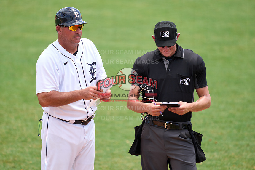 FCL Tigers West manager Ryan Minor (12) makes a lineup change with umpire Chase Eubanks during a game against the FCL Yankees on July 31, 2021 at Tigertown in Lakeland, Florida.  (Mike Janes/Four Seam Images)