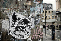 Catface sticker on a Shoreditch wall, East London http://www.vivecakohphotography.co.uk/2011/04/06/2982/