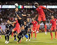 CHICAGO, IL - JULY 7: Raul Jimenez #9 heads a corner kick away from the goal during a game between Mexico and USMNT at Soldier Field on July 7, 2019 in Chicago, Illinois.