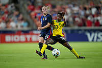 HOUSTON, TX - JUNE 13: Emily Sonnett #14 of the United States and Jody Brown #10 of Jamaica battle during a game between Jamaica and USWNT at BBVA Stadium on June 13, 2021 in Houston, Texas.