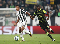 Football Soccer: UEFA Champions League Juventus vs Sporting Clube de Portugal, Allianz Stadium. Turin, Italy, October 18, 2017. <br /> Juventus Alex Sandro (l) in action withd Sporting CP captain William Carvalho (r) during the Uefa Champions League football soccer match between Juventus and Sporting Clube de Portugal at Allianz Stadium in Turin, October 18, 2017.<br /> UPDATE IMAGES PRESS/Isabella Bonotto