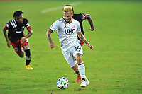 WASHINGTON, DC - SEPTEMBER 27: Diego Fagundez #14 of New England Revolution moves the ball during a game between New England Revolution and D.C. United at Audi Field on September 27, 2020 in Washington, DC.