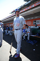 SAN FRANCISCO, CA - AUGUST 27:  Kyle Schwarber #12 of the Chicago Cubs gets ready in the dugout before the game against the San Francisco Giants at AT&T Park on Thursday, August 27, 2015 in San Francisco, California. Photo by Brad Mangin