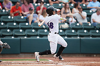 Luis Curbelo (16) of the Winston-Salem Dash follows through on his swing against the Greensboro Grasshoppers at Truist Stadium on June 19, 2021 in Winston-Salem, North Carolina. (Brian Westerholt/Four Seam Images)