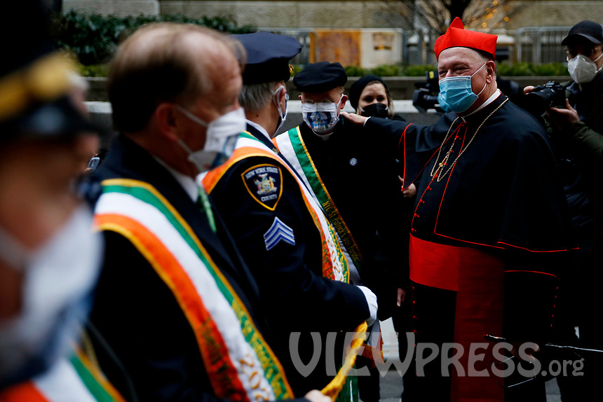 NEW YORK, NEW YORK - MARCH 17: The Cardinal Timothy Dolan (R) greets people attending St. Patrick's Day parade on March 17, 2021 in New York. St. Patrick's Day Parade organizers say they postpone the celebration, but a small group marched to preserve the tradition. (Photo by John Smith/VIEWpress)