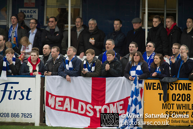 Wealdstone 0 Newport County 0, 17/03/2012. St Georges Stadium, FA Trophy Semi Final. Home supporters watching the action at St Georges Stadium, home ground of Wealdstone FC, as the club played host to Newport County (yellow) in the semi-final second leg of the F.A. Trophy. The game ended in a goalless draw, watched by a capacity crowd of 2,092 which meant the visitors from Wales progressed by three goals to one to the competition's final at Wembley, where they would meet York City. The F.A. Trophy was the premier cup competition for non-League clubs in England and Wales affiliated to the Football Association. Photo by Colin McPherson.