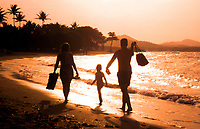 silhouette, Family composed of couple and a female child walking in sunset, in the beach of Puerto Plata, in Dominican Republic, Caribbean, Atlantic, Caribbean