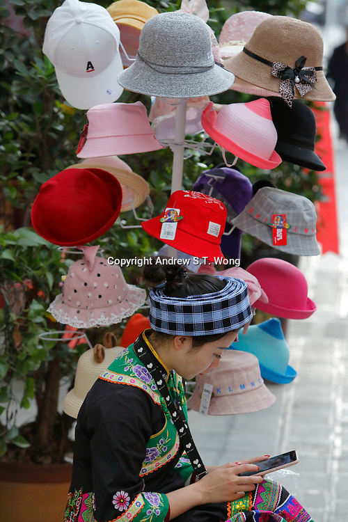 A vendor the ethnic Bouyei Tribe sells hats at Wangmo County in China's southwestern Guizhou Province, April 2019.