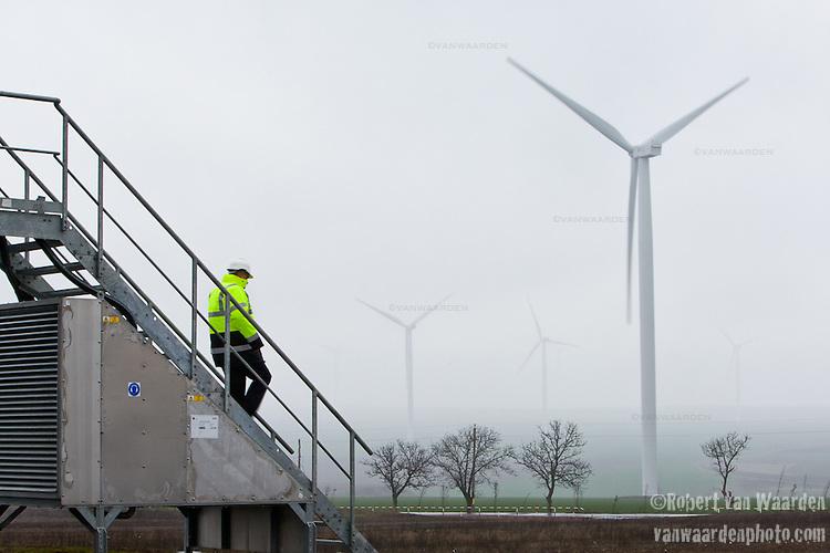 Miklos Szilagyi descends the stairs of a turbine on the Fantanele-Cogealac wind farm in Romania.