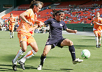 Lisa De Vanna #17 of Washington Freedom shields the ball from Collette McCallum #14 of Sky Blue FC during a WPS match at RFK Stadium on May 23, 2009 in Washington D.C. Freedom won the match 2-1