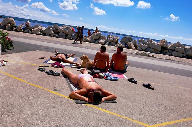 Friend sunbathing. Piran , Slovenia