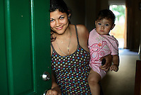 25 year old Elsie Savalba, a Honduran immigrant, stands in the doorway of her home in Manassas, Virginia with her one year old daughter Alison. Her house has plummeted in value over the last year from 295,000 USD to 150,000, and for the past six months Elsie has not been paying her mortgage. Soon they will be moving out. The area is suffering from a major collapse in the housing market following the subprime crisis and global credit crunch, which has forced the foreclosure and abandonment of numerous properties...
