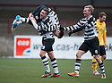 Shire's Max Wright (11) is lifted by Michael Hunter (6) after he scores their first goal.