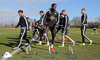Pictured: Bafetimbi Gomis (C) with other players Thursday 25 February<br />Re: Swansea City FC training at Fairwood, near Swansea, Wales, UK, ahead of their game against Tottenham Hotspur.