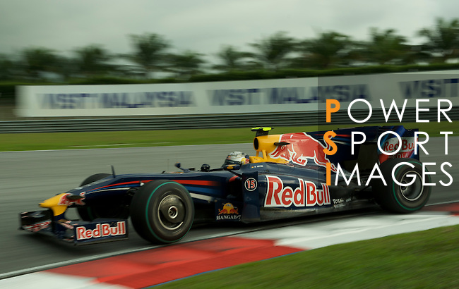 05 Apr 2009, Kuala Lumpur, Malaysia --- Red Bull Racing driver Sebastian Vettel of Germany steers his car during the 2009 Fia Formula One Malasyan Grand Prix at the Sepang circuit near Kuala Lumpur. Photo by Victor Fraile --- Image by © Victor Fraile / The Power of Sport Images