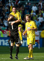 Danny O'Rourke celebrates with goalkeeper William Hesmer after a Chad Marshall, right, goal in the second half of the MLS Cup 2008, Columbus Crew vs New York Red Bulls, Sunday, November 23, 2008.