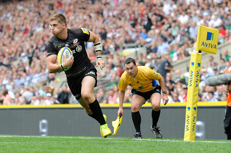 David Strettle of Saracens runs in a try during the Premiership Rugby Round 1 match between Saracens and Wasps at Twickenham Stadium on Saturday 6th September 2014 (Photo by Rob Munro)