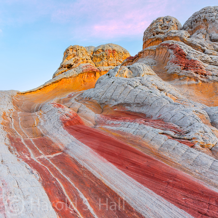 White Pocket within the Vermillion Cliffs area of northern Arizona is reached only with a four wheel drive vehicle, plowing through much deep sand. The White Pocket outcropping itself is quite small, but packed full of great sandstone outcroppings.