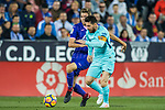 Lionel Andres Messi (r) of FC Barcelona fights for the ball with Gerard Gumbau Garriga of CD Leganes during the La Liga 2017-18 match between CD Leganes vs FC Barcelona at Estadio Municipal Butarque on November 18 2017 in Leganes, Spain. Photo by Diego Gonzalez / Power Sport Images