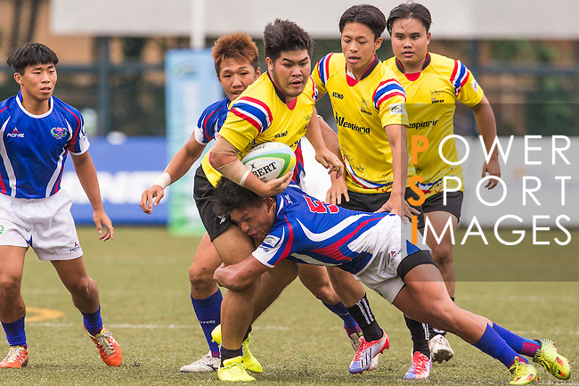 Natthanan Chankhieo of Thailand battles for the ball against Po-wen Pan of Chinese Taipei during the match between Chinese Taipei and Thailand of the Asia Rugby U20 Sevens Series 2016 on 12 August 2016 at the King's Park, in Hong Kong, China. Photo by Marcio Machado / Power Sport Images