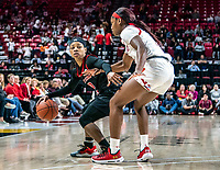 COLLEGE PARK, MD - FEBRUARY 9: Kaila Charles #5 of Maryland closes down Khadaizha Sanders #12 of Rutgers during a game between Rutgers and Maryland at Xfinity Center on February 9, 2020 in College Park, Maryland.