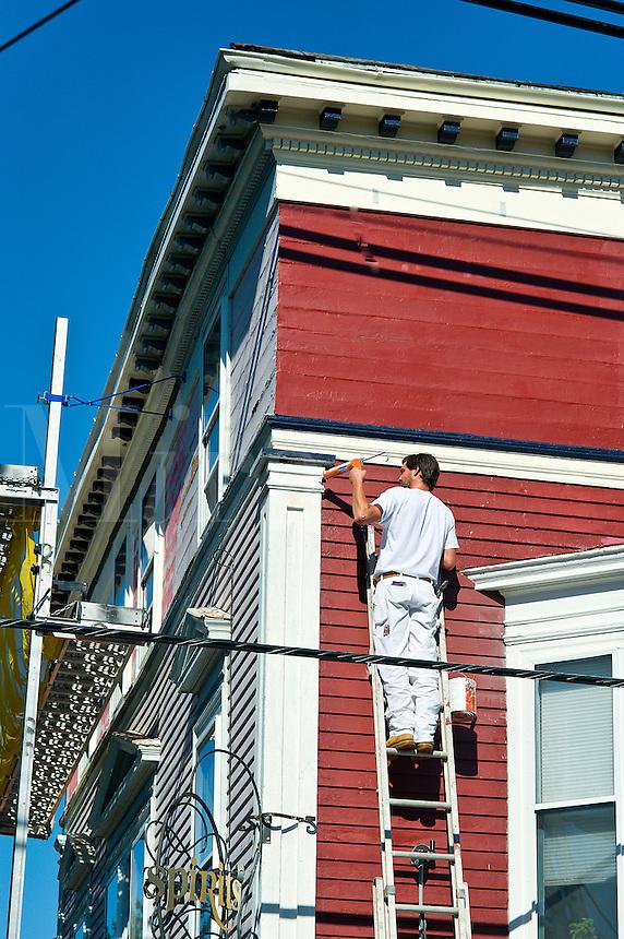 Man painting a victorian house, Newport, RI, Rhode Island