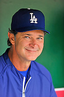 5 September 2011: Los Angeles Dodgers Manager Don Mattingly smiles in the dugout prior to a game against the Washington Nationals at Nationals Park in Los Angeles, District of Columbia. The Nationals defeated the Dodgers 7-2 in the first game of their 4-game series. Mandatory Credit: Ed Wolfstein Photo