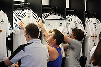 Pictured: Supporters flock to the club shop to be the first to buy the new shirts. Saturday 21 June 2014<br /> Re: Launch of the new home and away kit for Swansea City Football Club at the Liberty Stadium, south Wales.