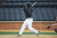 Bobby Seymour (3) of the Wake Forest Demon Deacons follows through on his swing against the Virginia Cavaliers at David F. Couch Ballpark on May 18, 2018 in  Winston-Salem, North Carolina.  The Cavaliers defeated the Demon Deacons 15-3.  (Brian Westerholt/Four Seam Images)