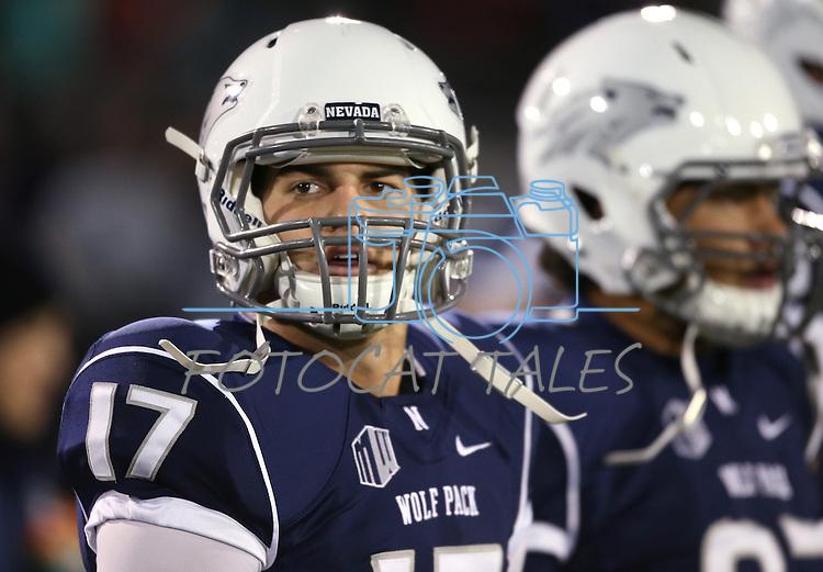Nevada's quarterback Cody Fajardo plays in an NCAA college football game against San Jose State, in Reno, Nev., on Saturday, Nov. 16, 2013. (AP Photo/Cathleen Allison)