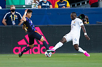 CARSON, CA - JUNE 19: Sega Coulibaly #4of the Los Angeles Galaxy and Fredy Montero #12 of the Seattle Sounders FC battle for a ball during a game between Seattle Sounders FC and Los Angeles Galaxy at Dignity Health Sports Park on June 19, 2021 in Carson, California.