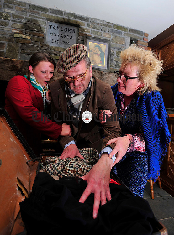 Sean Dunleavy packs his bags for America at the launch of the American Wake in aid of Croi at Clancy's Moyasta. Also pictured are Roisin Latham and Margaret Whelan. Photograph by Declan Monaghan