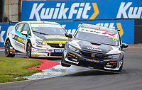 29th August 2020; Knockhill Racing Circuit, Fife, Scotland; Kwik Fit British Touring Car Championship, Knockhill, Qualifying Day; Dan Cammish lifts his car off the ground on the curbs as he is pursued by Mike Bushell