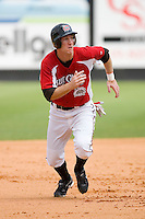 Todd Frazier #30 of the Carolina Mudcats takes off for third base at Five County Stadium August 16, 2009 in Zebulon, North Carolina. (Photo by Brian Westerholt / Four Seam Images)