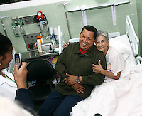 Venezuelan President Hugo Chavez visits a patient in a new medical center in the poor district of Caricuao in Western Caracas.