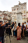 Tourist Visiting Statue