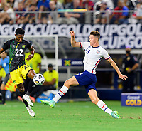 DALLAS, TX - JULY 25: Matthew Hoppe #13 of the United States and Devon Williams #22 of Jamaica battle for control of the ball during a game between Jamaica and USMNT at AT&T Stadium on July 25, 2021 in Dallas, Texas.