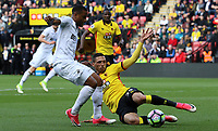 Luciano Narsingh of Swansea City is challenged by Jose Holebas of Watford during  the Premier League match between Watford and Swansea City at Vicarage Road Stadium, Watford, England, UK. Saturday 15 April 2017