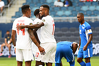 KANSASCITY, KS - JULY 11: Mark-Anthony Kaye #14and Cyle Larin  #17 of Canada celebrate a goal during a game between Canada and Martinique at Children's Mercy Park on July 11, 2021 in KansasCity, Kansas.