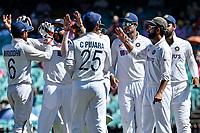 9th January 2021; Sydney Cricket Ground, Sydney, New South Wales, Australia; International Test Cricket, Third Test Day Three, Australia versus India; Cheteshwar Pujaraof India and the Indian team celebrate the wicket of Will Pucovski of Australia