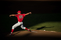Kevin Ginkel #22 of the Arizona Wildcats pitches during a College World Series Finals game between the Coastal Carolina Chanticleers and Arizona Wildcats at TD Ameritrade Park on June 28, 2016 in Omaha, Nebraska. (Brace Hemmelgarn/Four Seam Images)