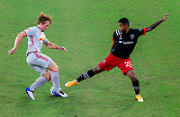 WASHINGTON, DC - SEPTEMBER 12: Tim Parker #26 of the New York Red Bulls defends Gelmin Rivas #20 of D.C. United during a game between New York Red Bulls and D.C. United at Audi Field on September 12, 2020 in Washington, DC.