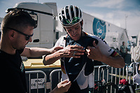 German National Champion Marcus Burghardt (DEU/BORA-hansgrohe) being helped getting a towl inside his jersey to protect him from cold when descending back down the mountain<br /> <br /> 104th Tour de France 2017<br /> Stage 5 - Vittel › La Planche des Belles Filles (160km)